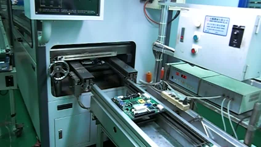Pcbas goes into throughhole IRreflow machine after manual insertion.ogv
