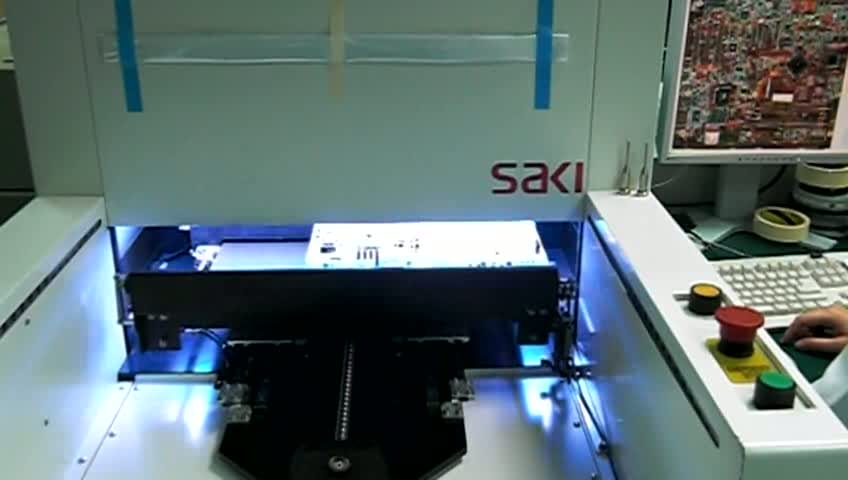 Pcba goes into AOI machine to scan.ogv